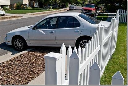 Car In Fence